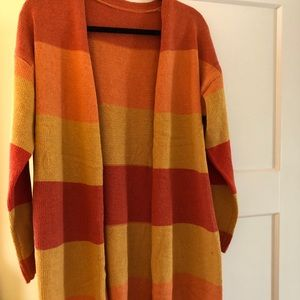 Never worn cozy cardigan size Small- great colors!